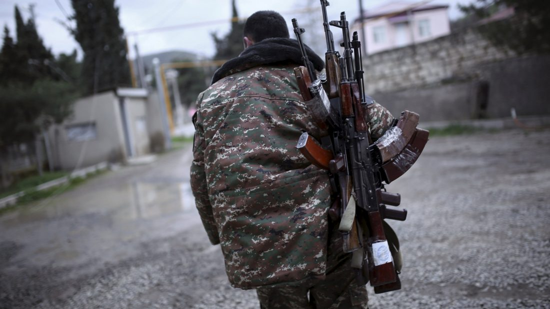 A soldier of the self-defense army of Nagorno-Karabakh carries weapons in Martakert province, which according to Armenian media was affected by clashes over the breakaway Nagorno-Karabakh region, April 4, 2016. REUTERS/Vahan Stepanyan/PAN Photo EDITORIAL USE ONLY. NO RESALES. NO ARCHIVE.